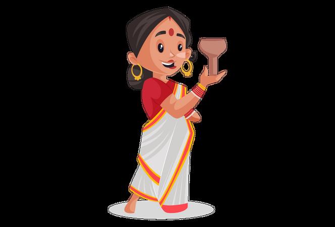 Bengali woman holding lamp for worship of Goddess Durga Illustration