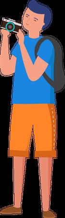 Boy clicking photograph Illustration