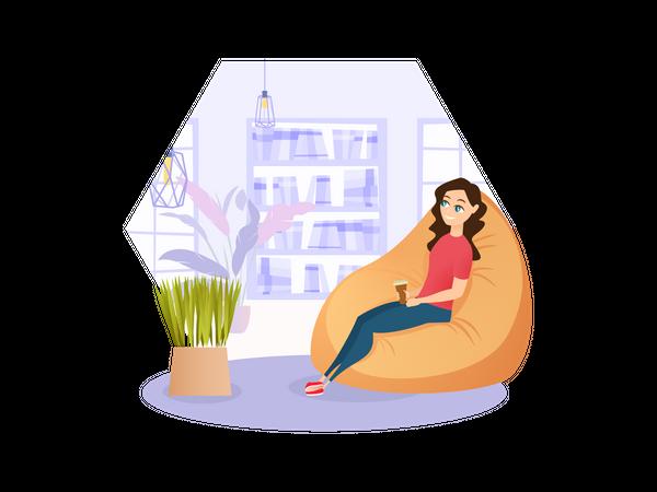 Female employee sitting on beanbag Illustration