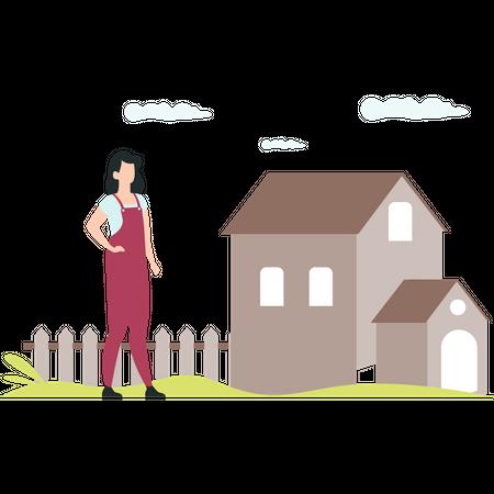 Female gardener standing near house Illustration