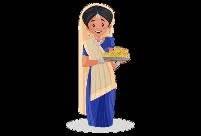 Gujarati woman holding sweet dish in her hand Illustration