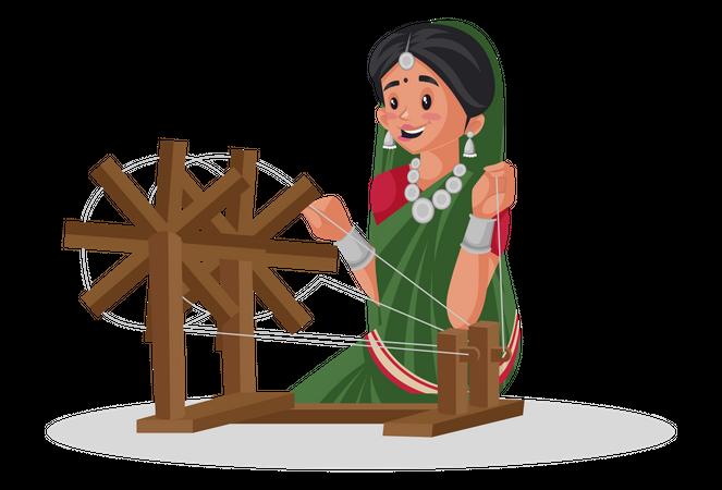Gujarati woman is working on a spinning wheel Illustration