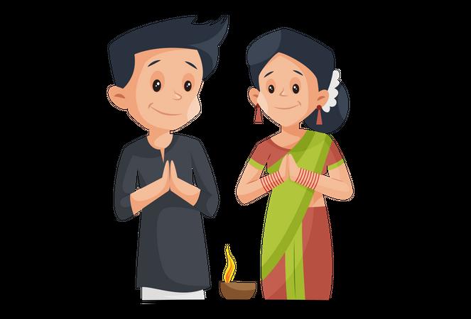 Indian couple with Namaste pose with Diya on Diwali festival Illustration