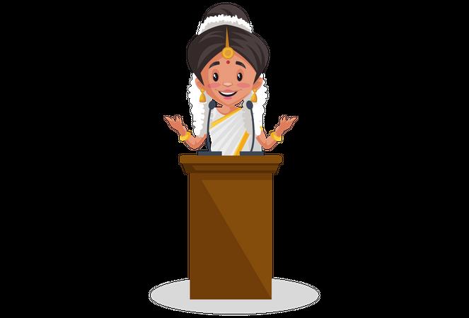 Indian Malayali woman giving speech on the podium Illustration