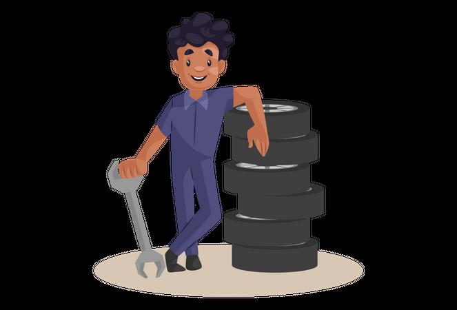 Indian Mechanic standing near wheels Illustration