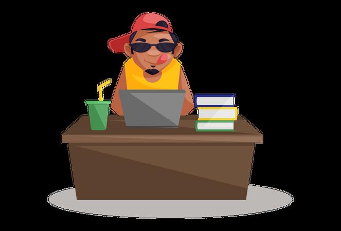 Indian Photographer doing work on laptop sitting on desk Illustration