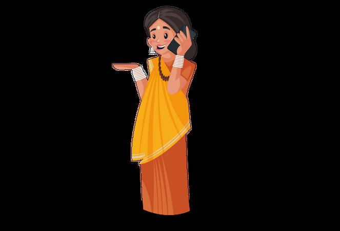 Indian priestess talking on mobile phone Illustration