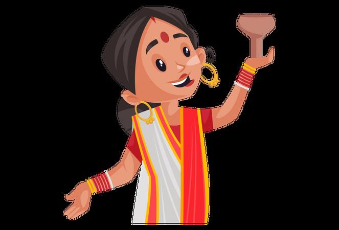 Indian woman holding lamp Illustration