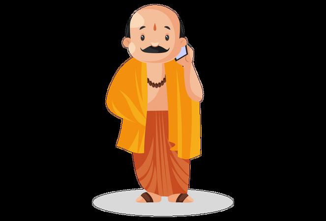 Male pandit talking on phone Illustration