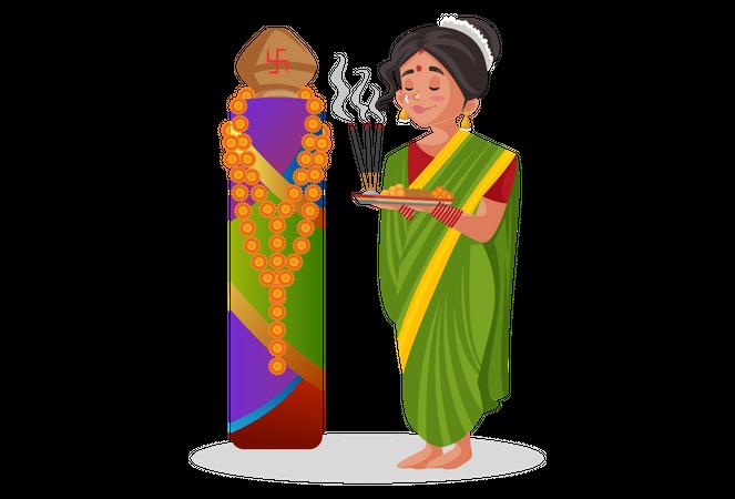 Marathi woman doing worshiping with Puja thali Illustration