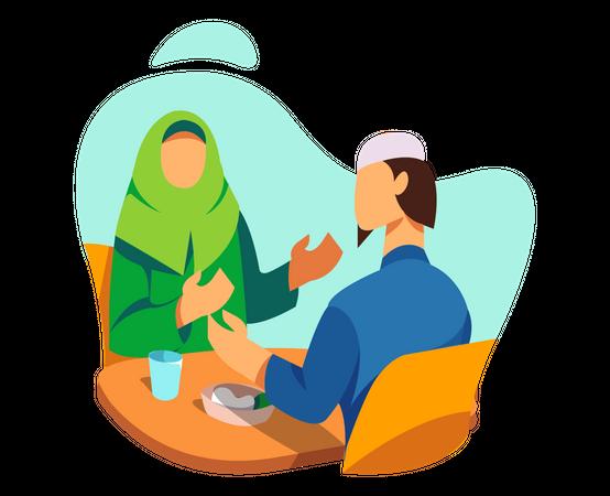 Muslim couple enjoying iftar meal Illustration