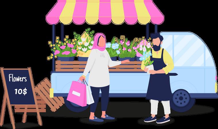 Muslim woman buying flowers from Caucasian man Illustration