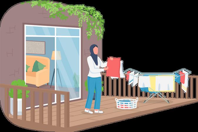 Muslim woman hanging laundry outside Illustration