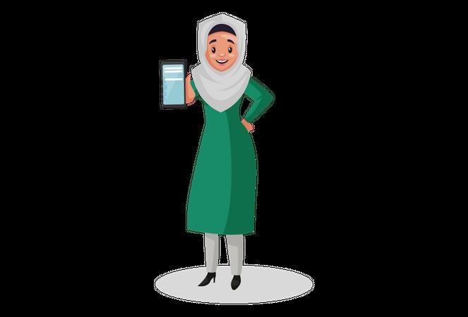 Muslim woman showing mobile Illustration