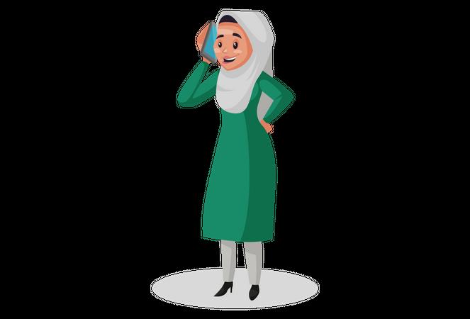 Muslim woman talking on mobile Illustration