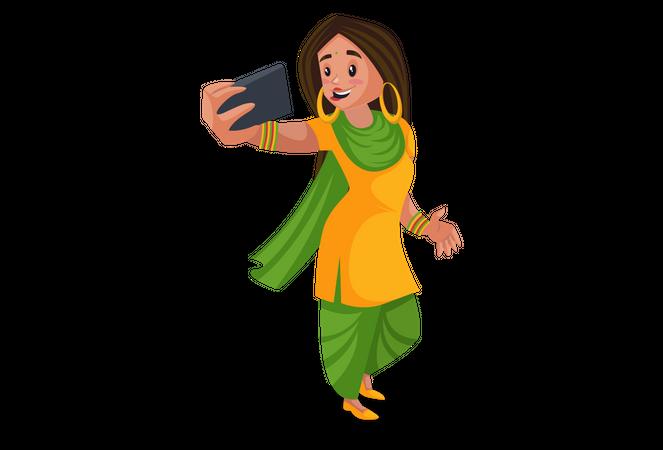 Punjabi girl taking selfies on the mobile Illustration