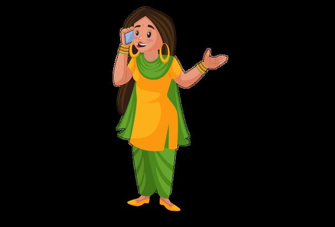 Punjabi girl talking on a mobile phone Illustration
