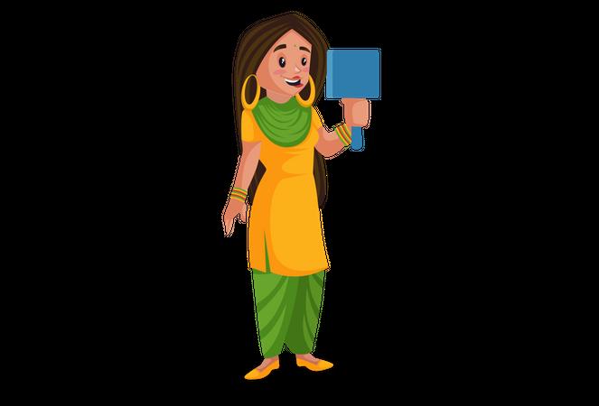 Punjabi girl watching herself in the mirror Illustration