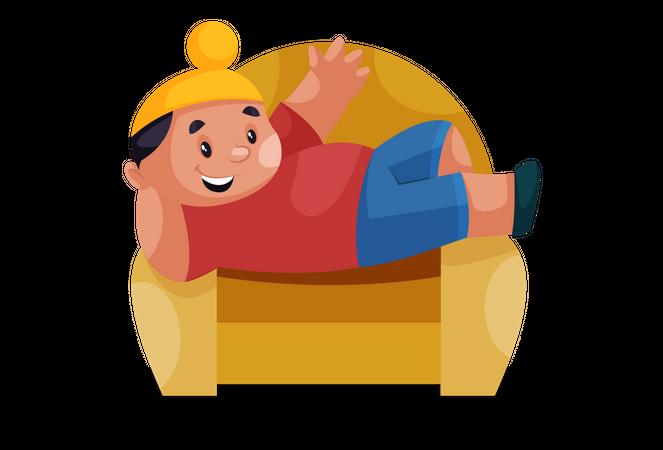 Punjabi kid lying down on a sofa Illustration