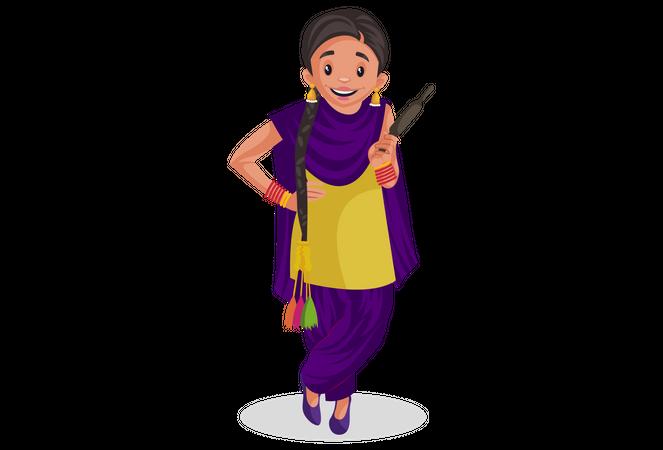Punjabi woman holding roller pin Illustration