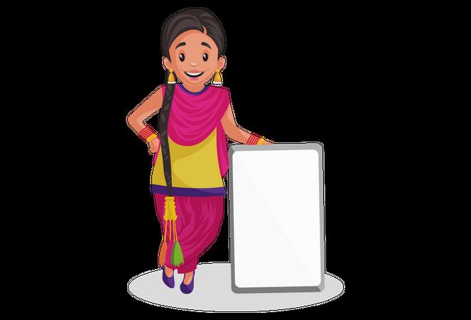 Punjabi woman standing near blank board Illustration