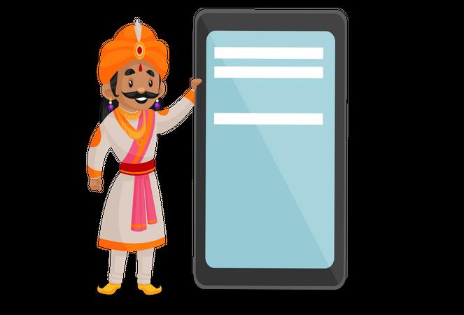 Samrat Ashok standing beside mobile Illustration