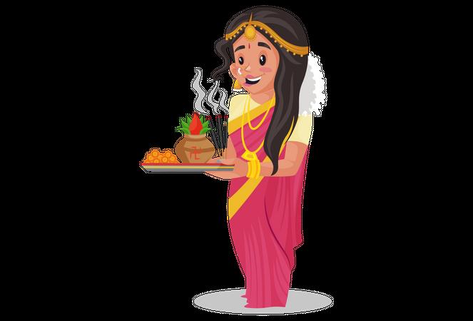 Tamil woman holding worship plate Illustration